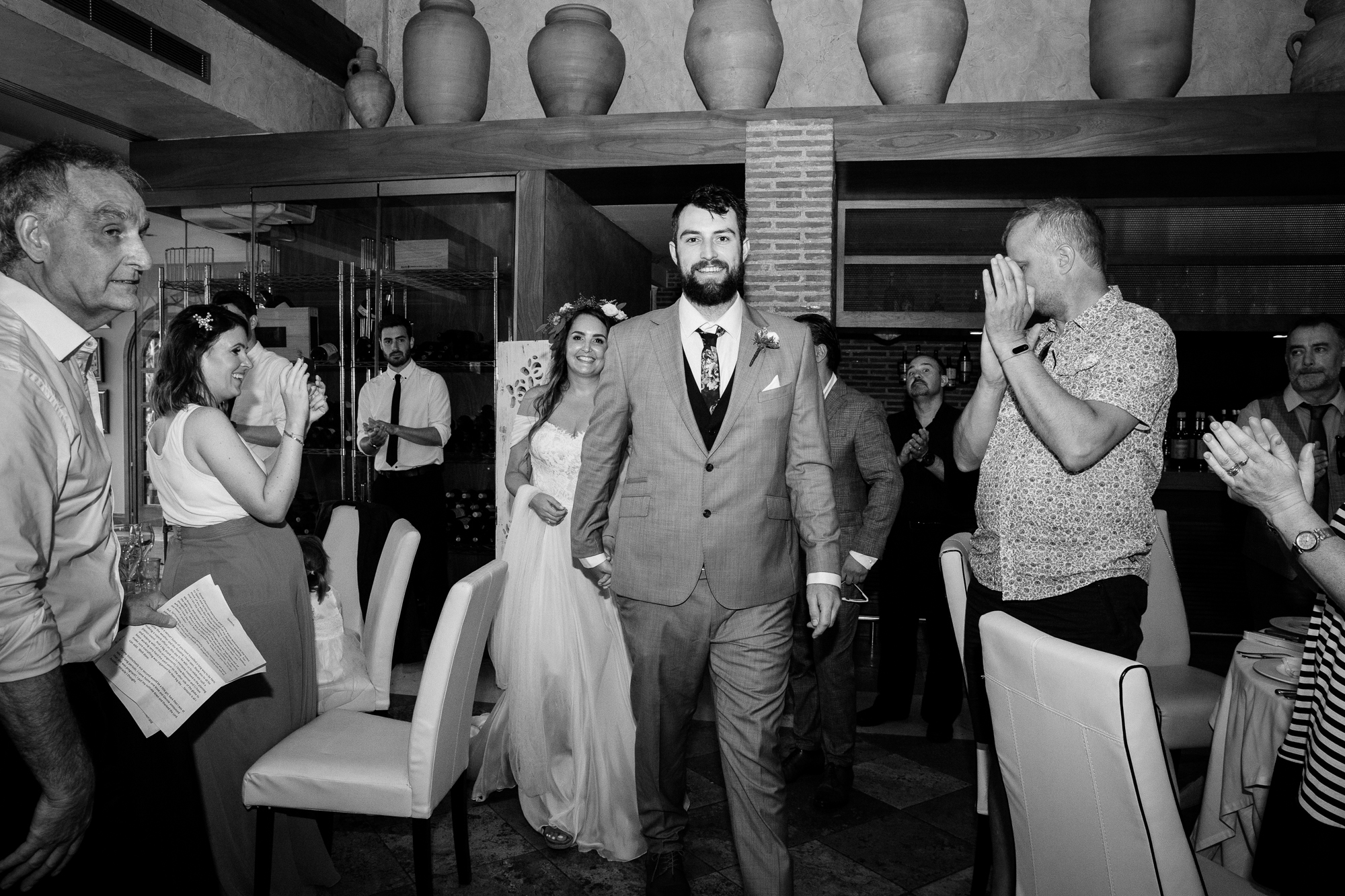 couple enter wedding reception at Hotel Les Rotes in denia