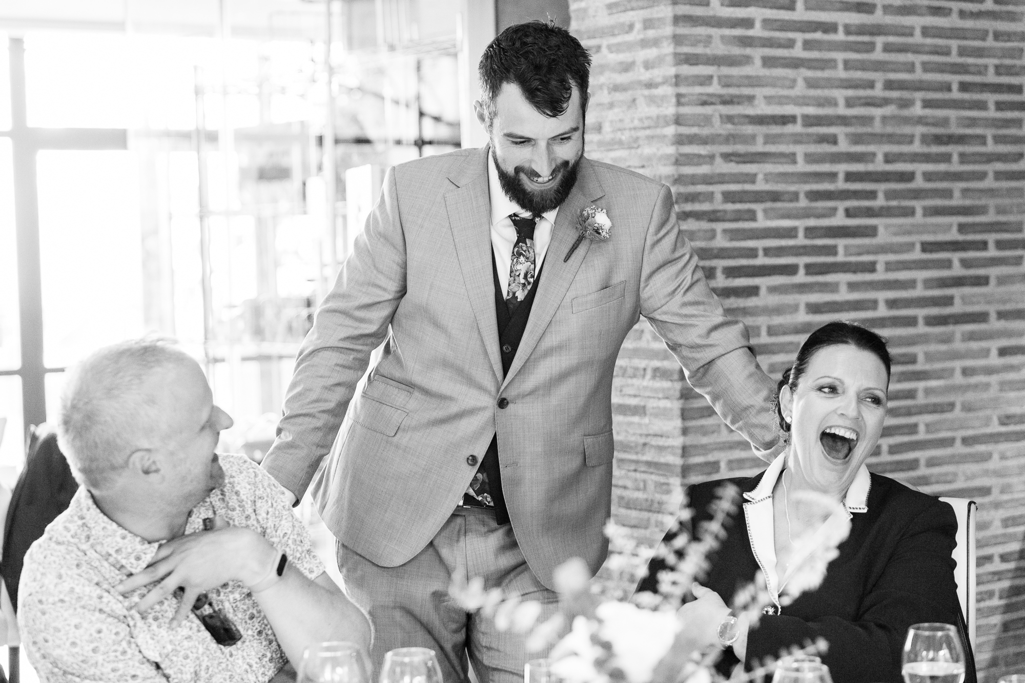 groom laughs with wedding guests in Denia wedding