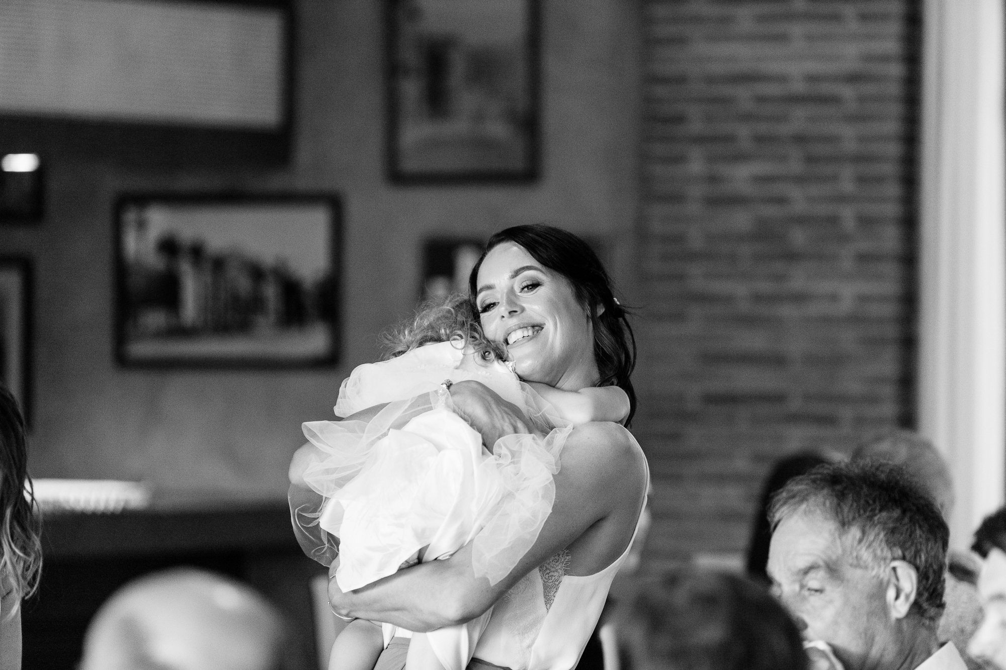 mum hugs her daughter at wedding reception at Hotel Les Rotes