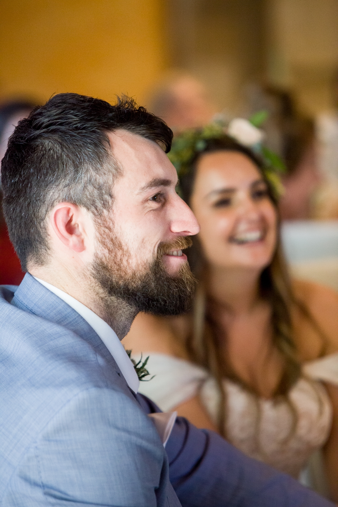 groom laughs during the speeches of his Denia wedding