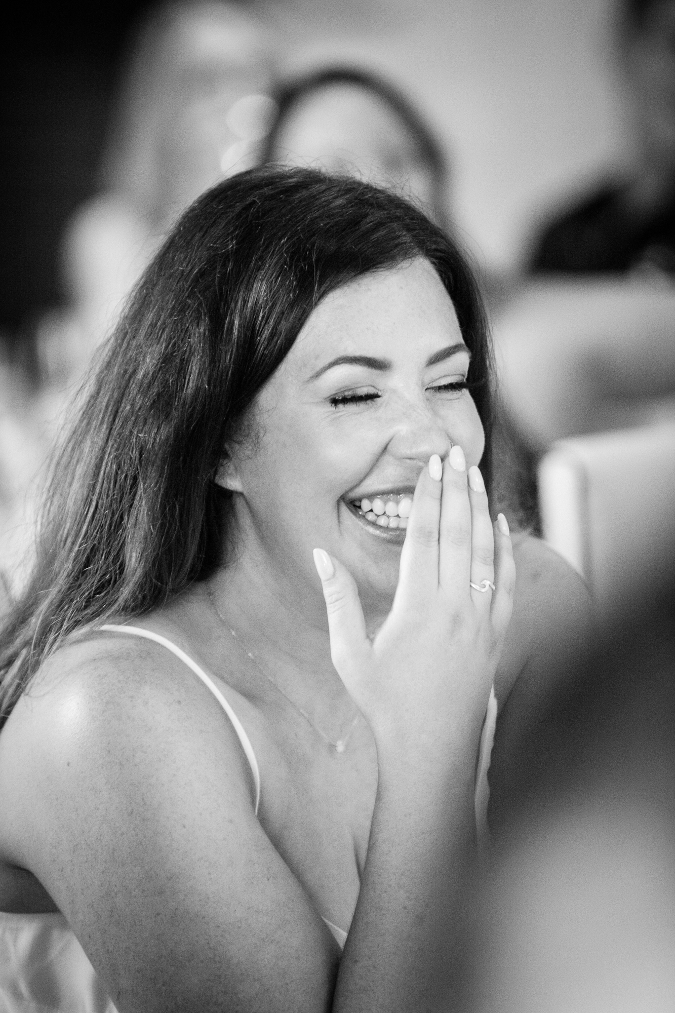 girl laughs during wedding speeches