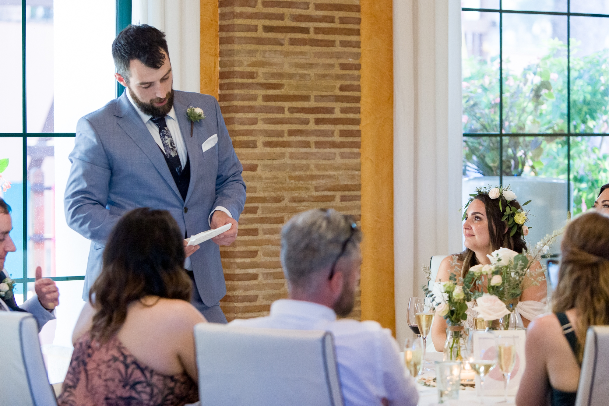 groom gives speech at wedding breakfast in hotel les rotes, denia