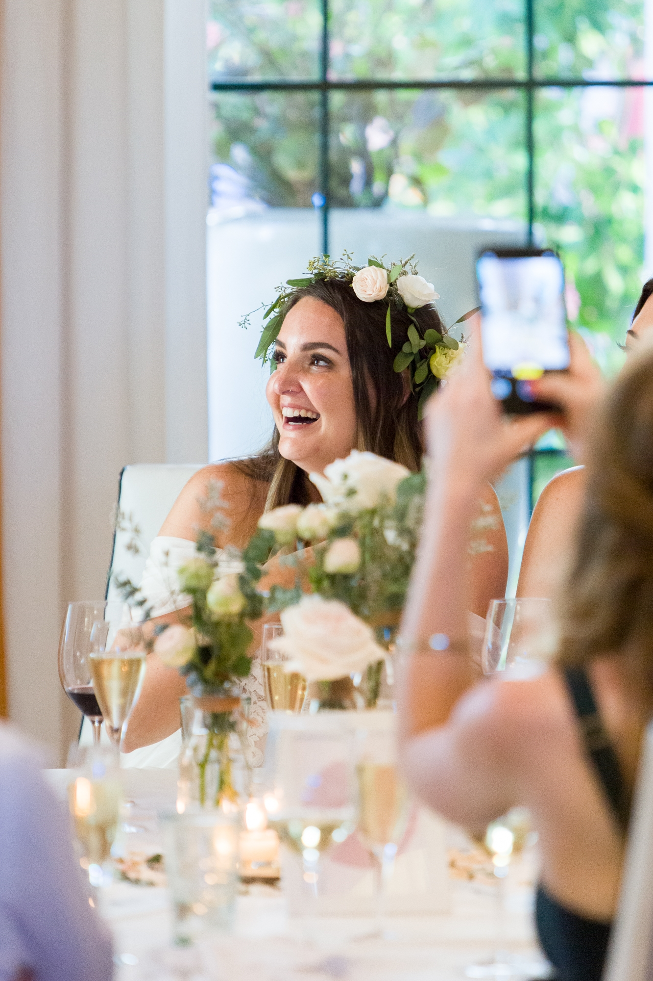 bride at hotel les rotes in denia laughs at groom during speeches