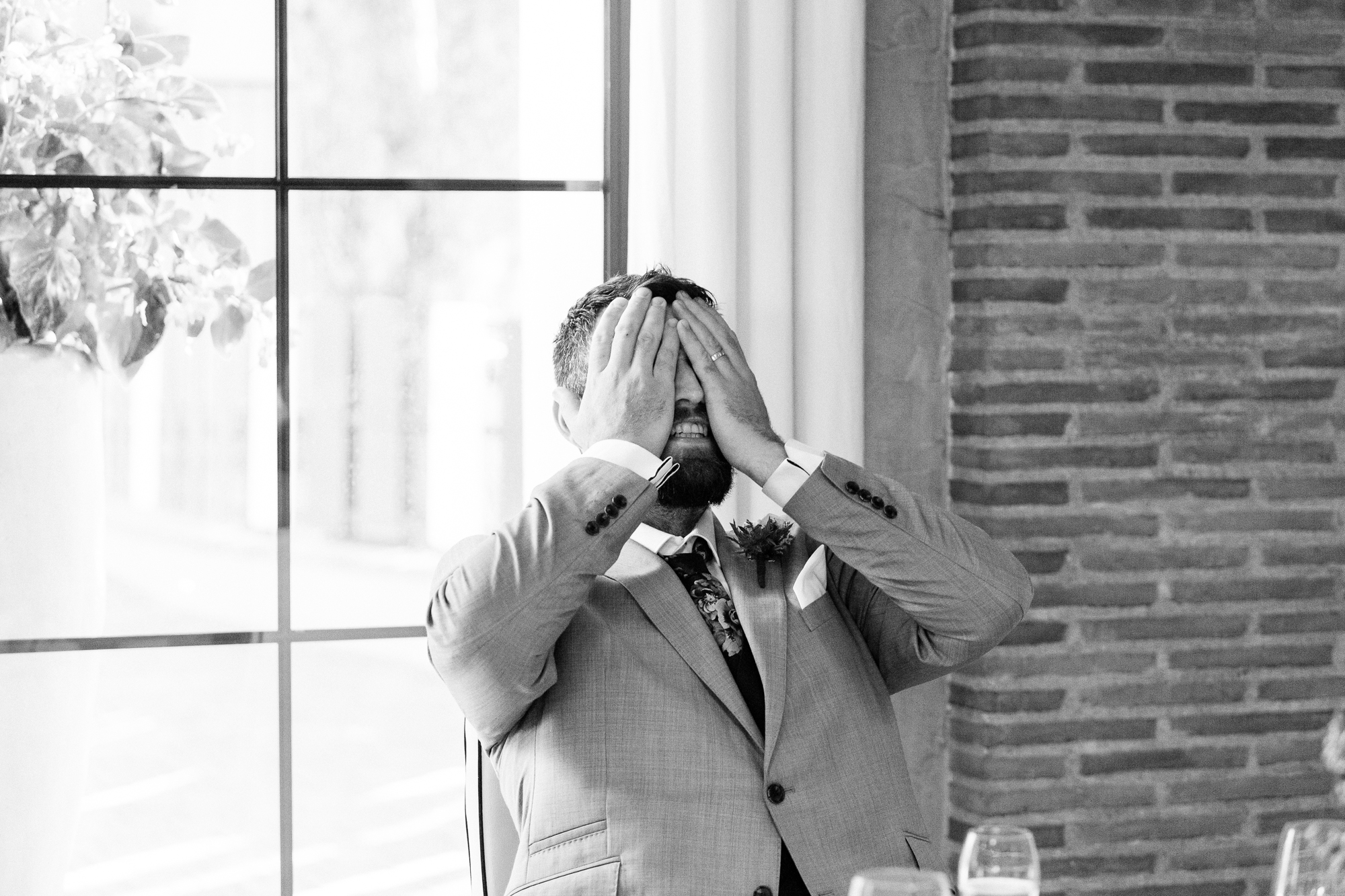 groom covers his face during wedding speeches in denia