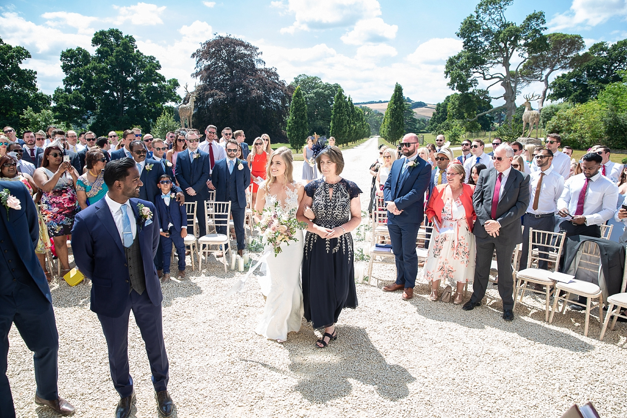 mother walks the bride down the aisle at outdoors Pynes house wedding