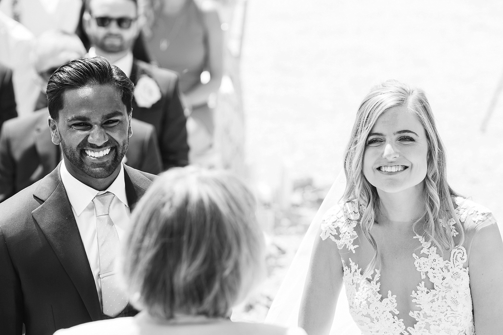 black and white as bride and groom laugh at Pynes house wedding