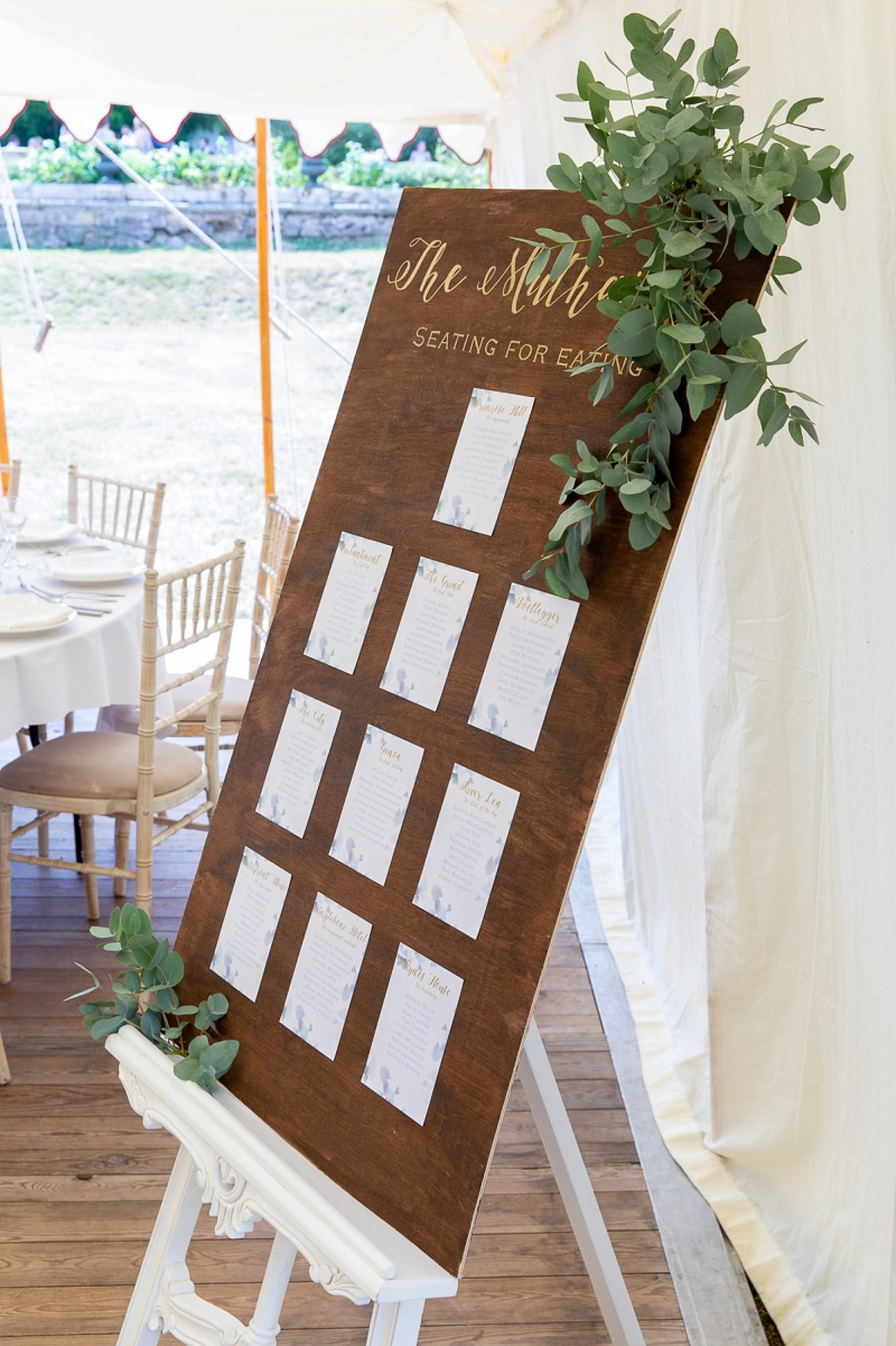 Table plan with eucalyptus leaf hanging down on the right side
