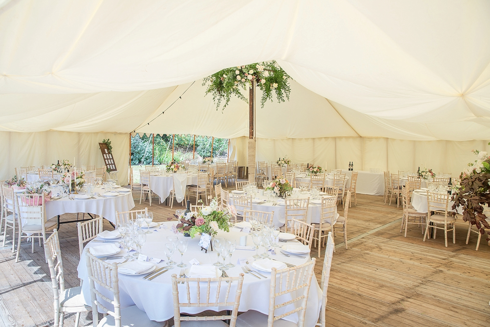 wedding marquee at Pynes House wedding with a large central pole with flowers