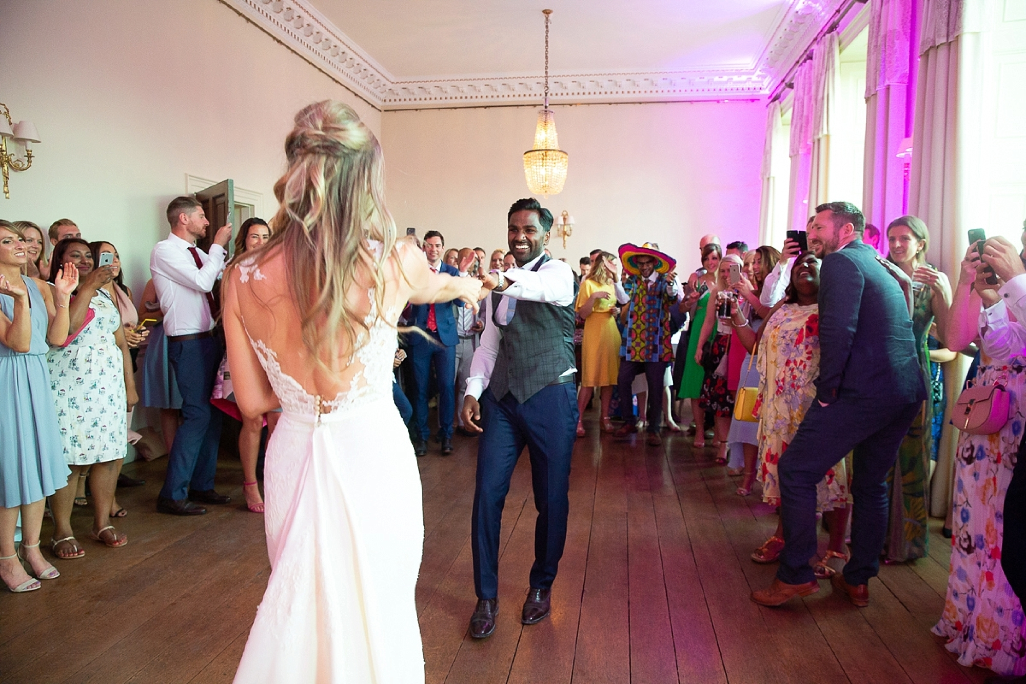 bride and groom dance in the main ballroom of Pynes house