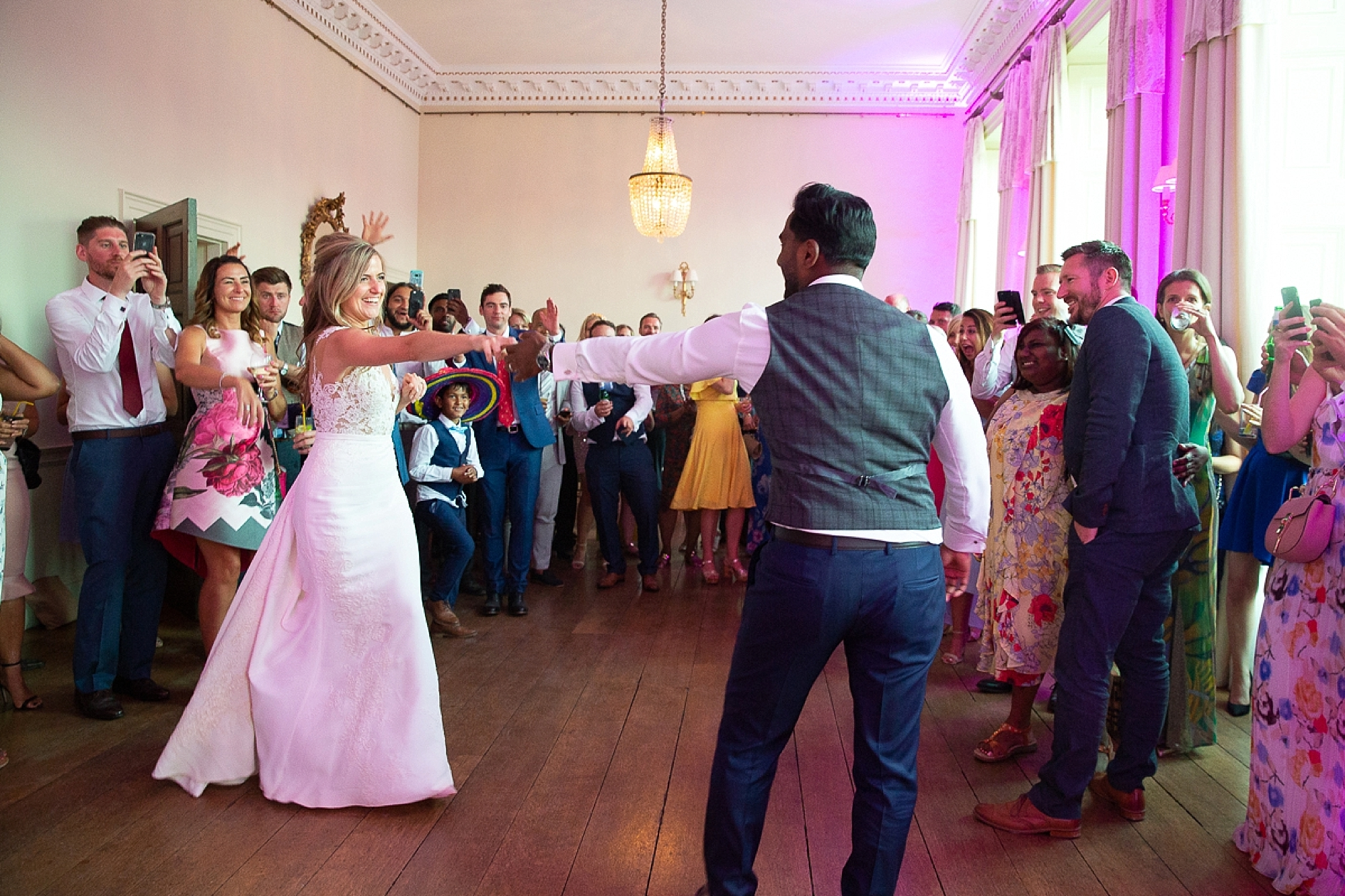 bride and groom dance in the main ballroom of Pynes house at Devon wedding