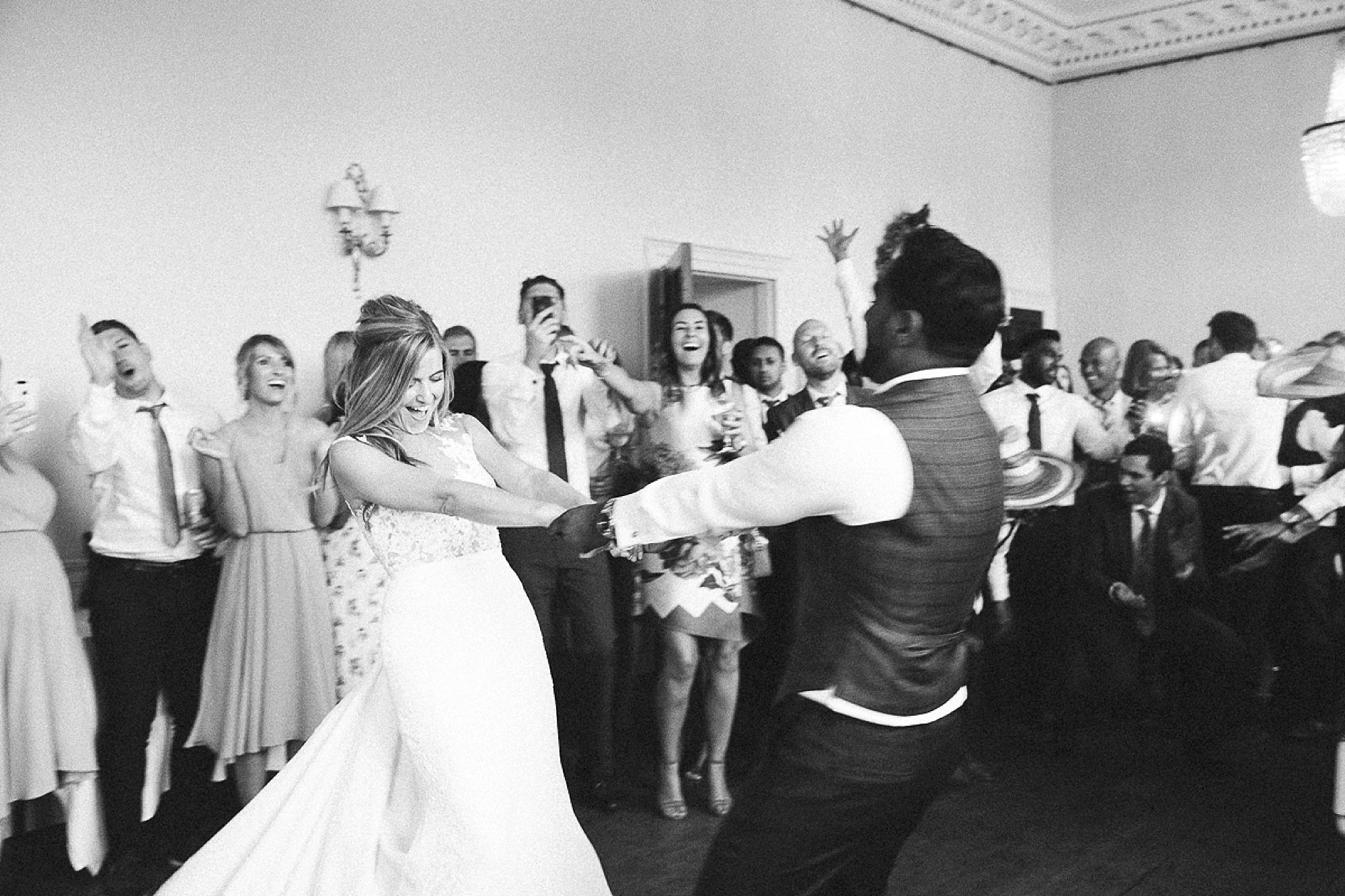 bride and groom dance at Pynes house wedding in black and white