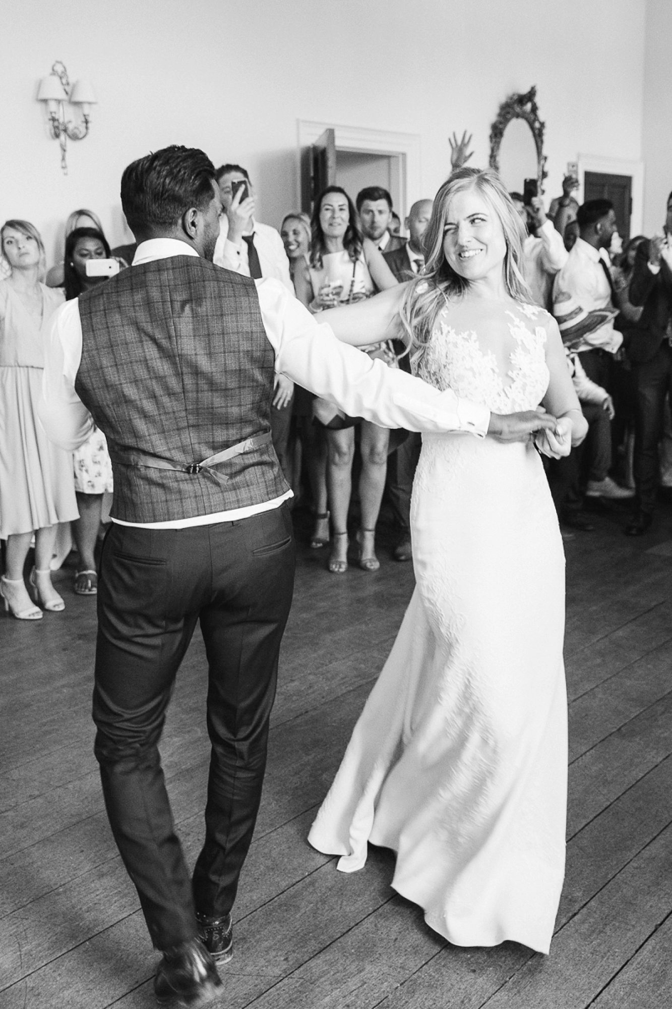 bride and groom dancing at Pynes house wedding in black and white