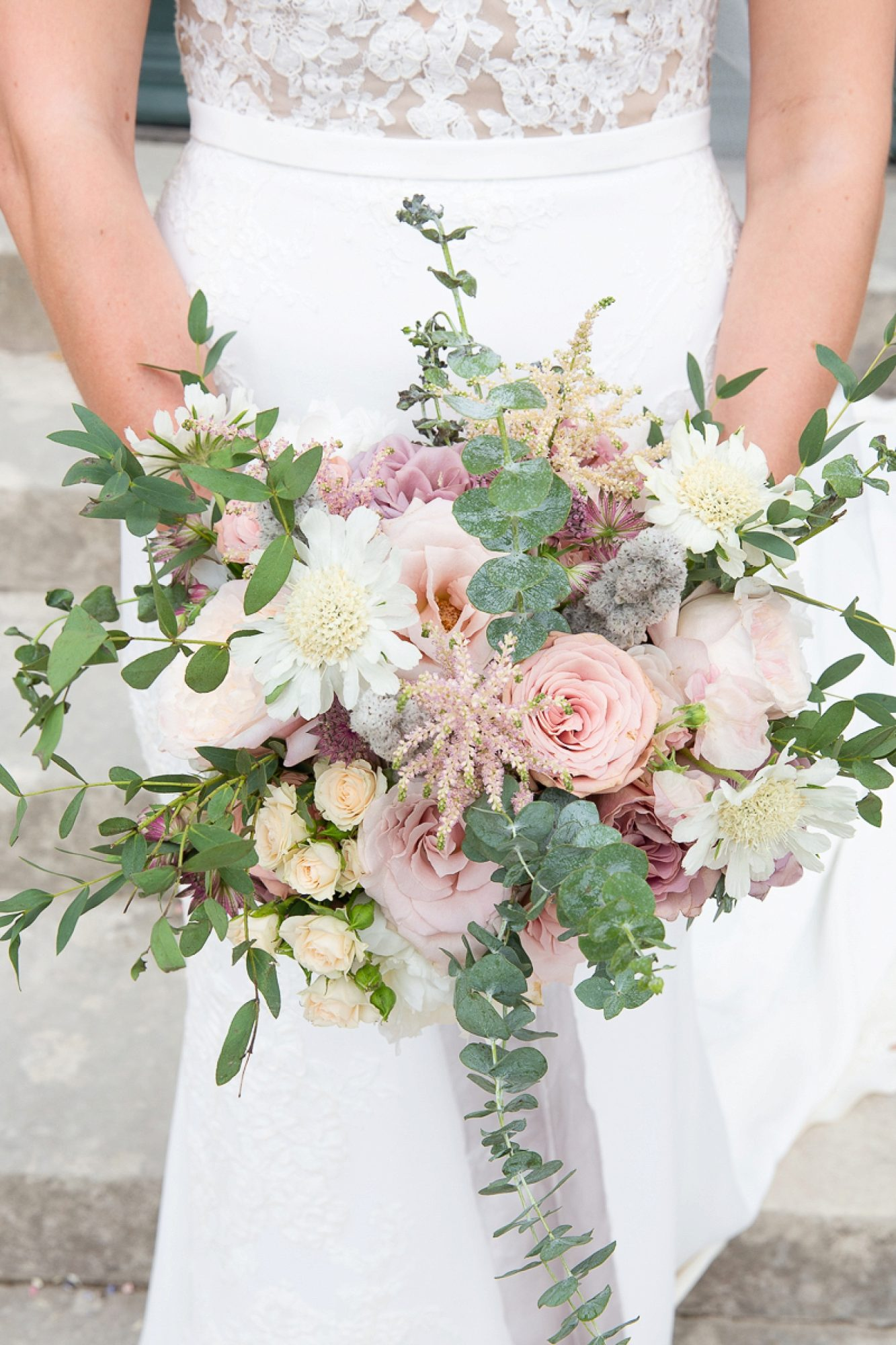 bridal bouquet with pinks and white flowers outside the entrance of Pynes house