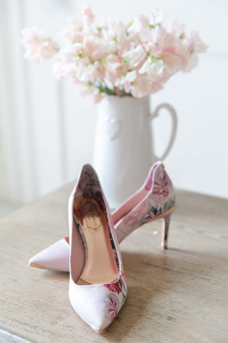 pink shoes with flower behind