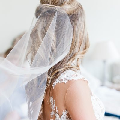 bride with veil turns her head at Pynes House in Exeter wedding
